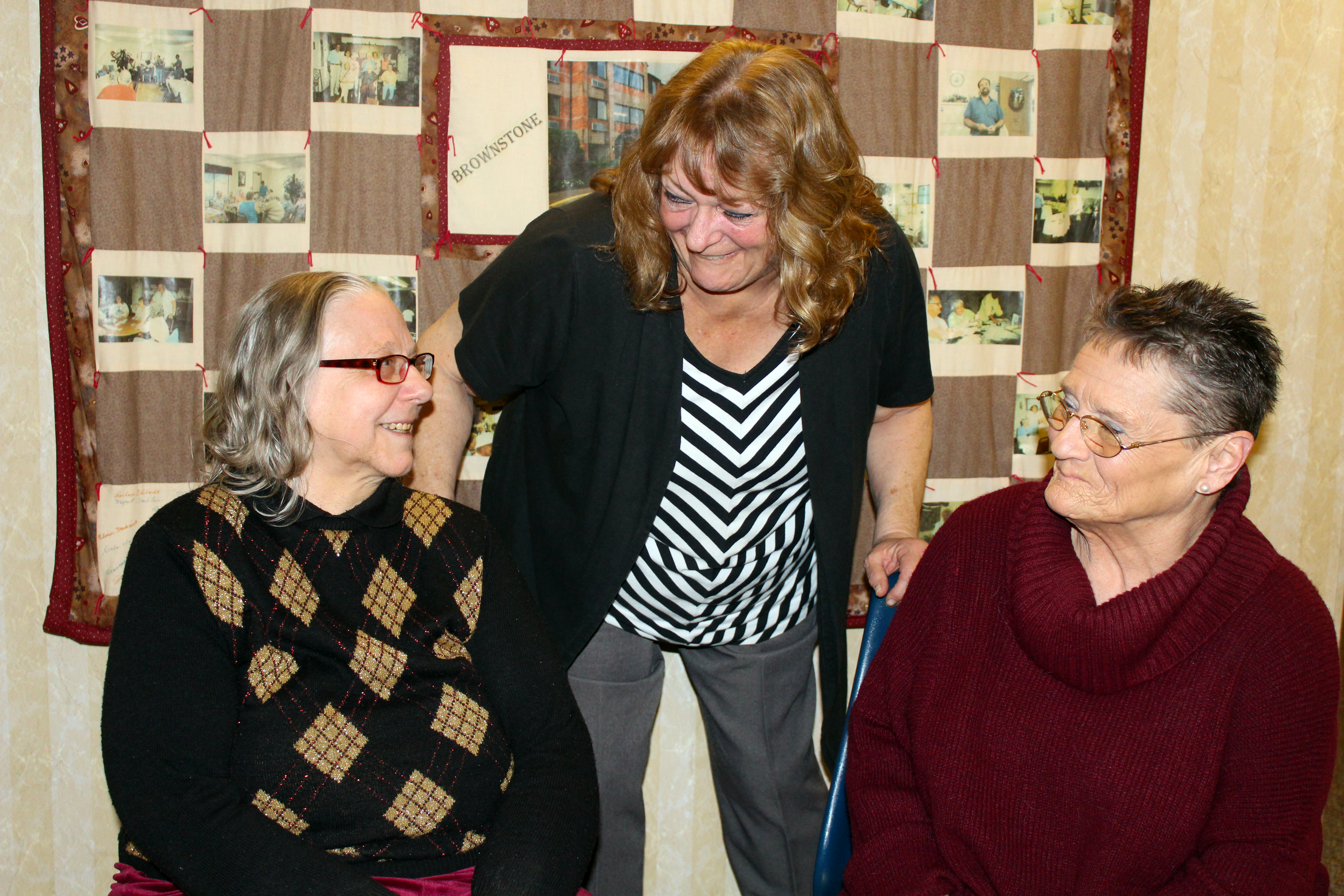 Sandy Crane (left) and Caroline Smothers (right) with United Church Homes' Brownstone Terrace Housing Manager Jane Millisor.