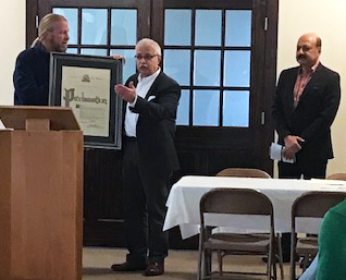 "Alderman Dan Guenther presents a ""Salam Clinic Day"" proclamation to Zia Ahmad, M.D., and Nabil Ahmad, M.D."